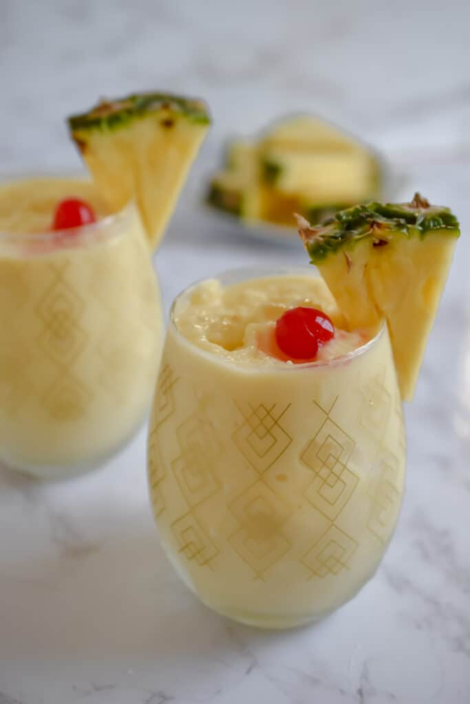 Two pina coladas with cherries on top