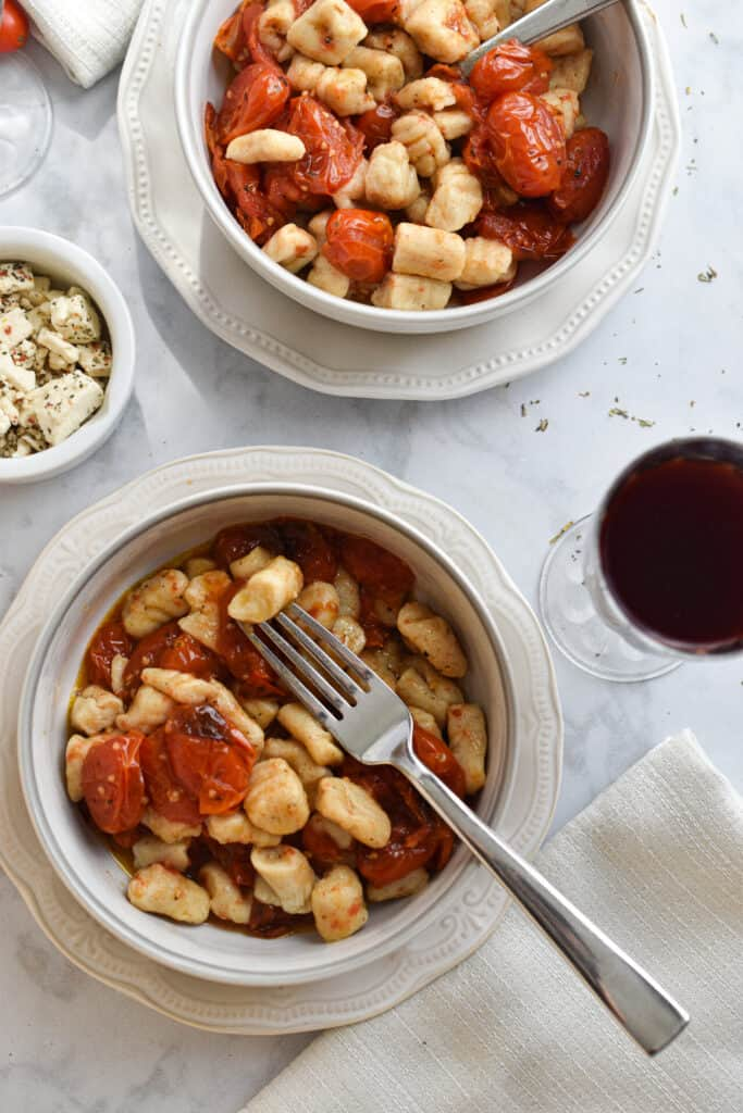 Plated gnocchi with cherry tomato sauce