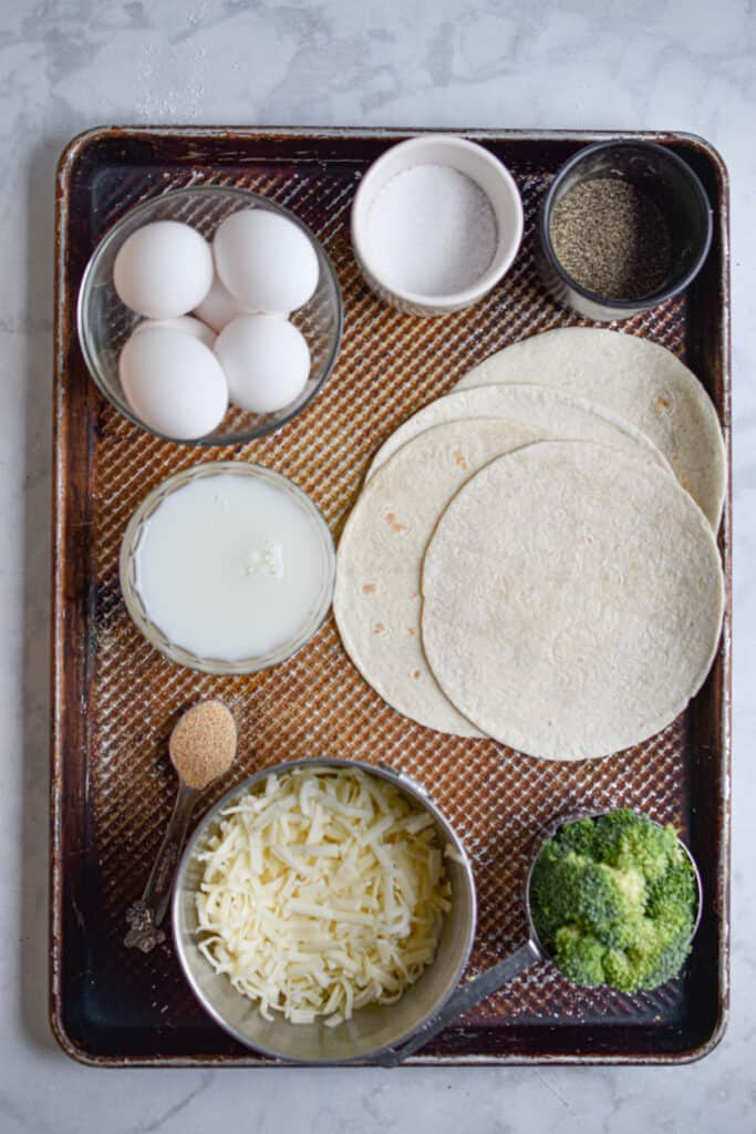 Ingredients for broccoli cheddar quiche with tortilla crust