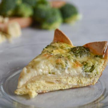 Slice of broccoli cheddar with tortilla crust