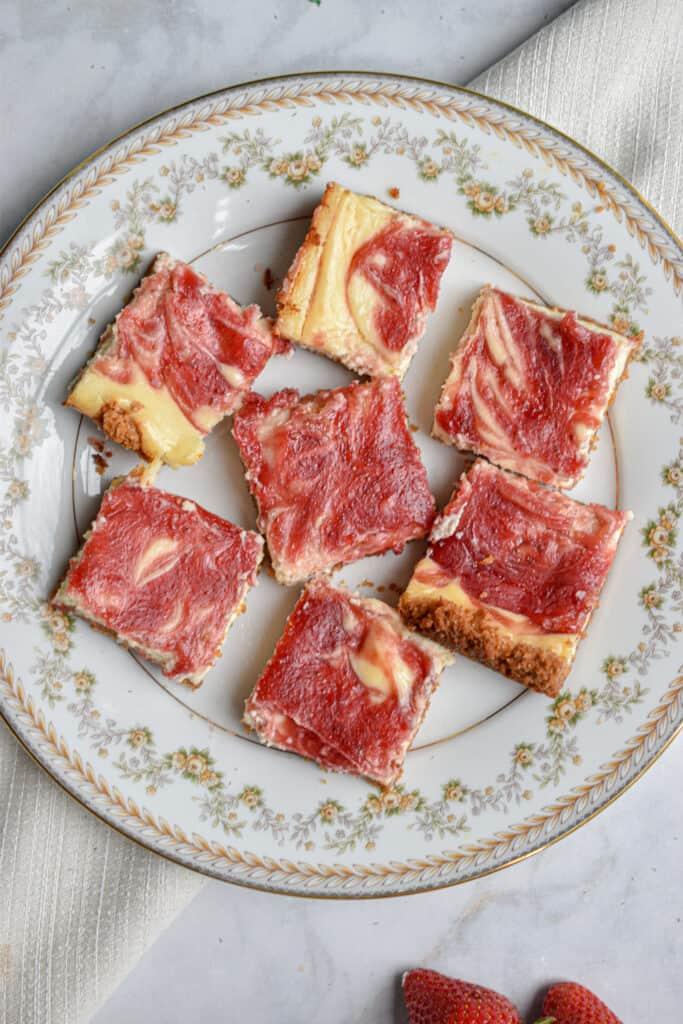 Slices of strawberry swirl cheesecake bars