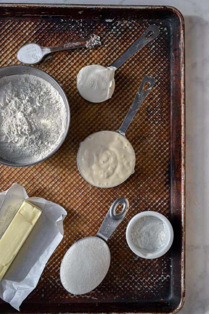 Ingredients for the scones. Flour, Butter, Starter, sugar, baking powder, baking soda, and sour cream