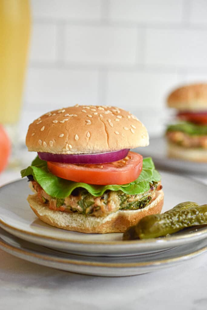 Chicken burgers with feta and spinach served with a beer