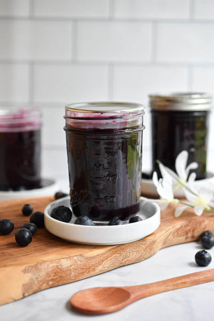 Blueberry Jam styled in front of a subway tile backdrop