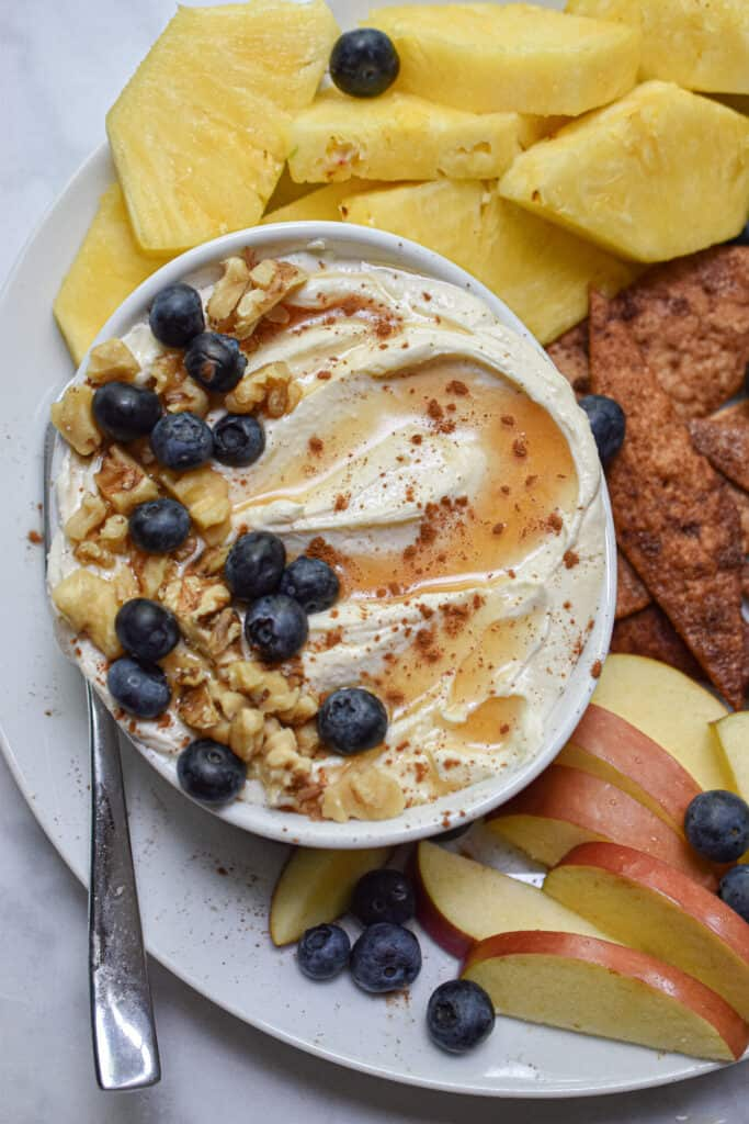 whipped feta dip with honey topped with honey and blueberries