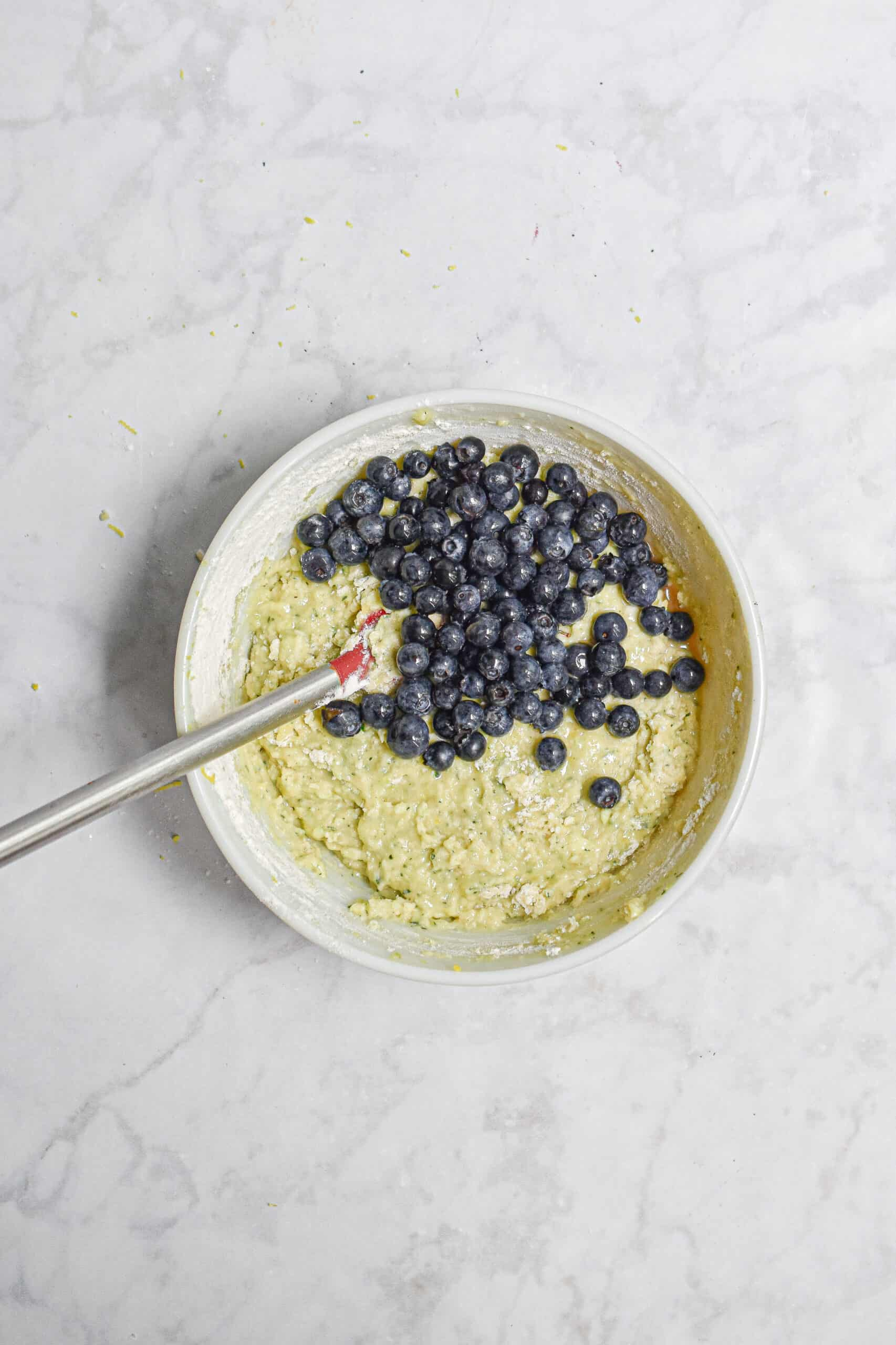 The blueberries are added to the batter for the Lemon and blueberry zucchini bread with lemon icing