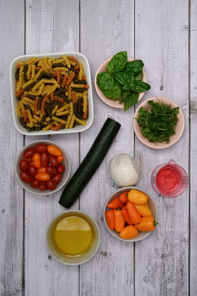 Ingredients for the garden vegetable and herb pasta salad laid out