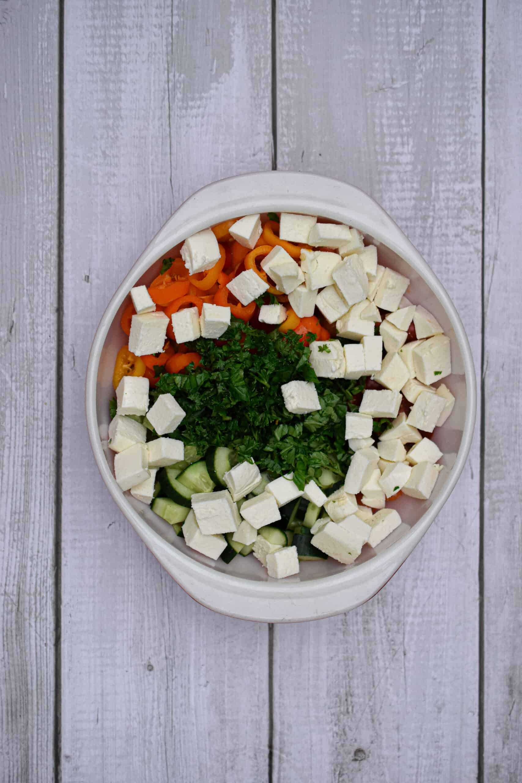 The chopped fresh mozzarella and chopped herbs are added to the bowl