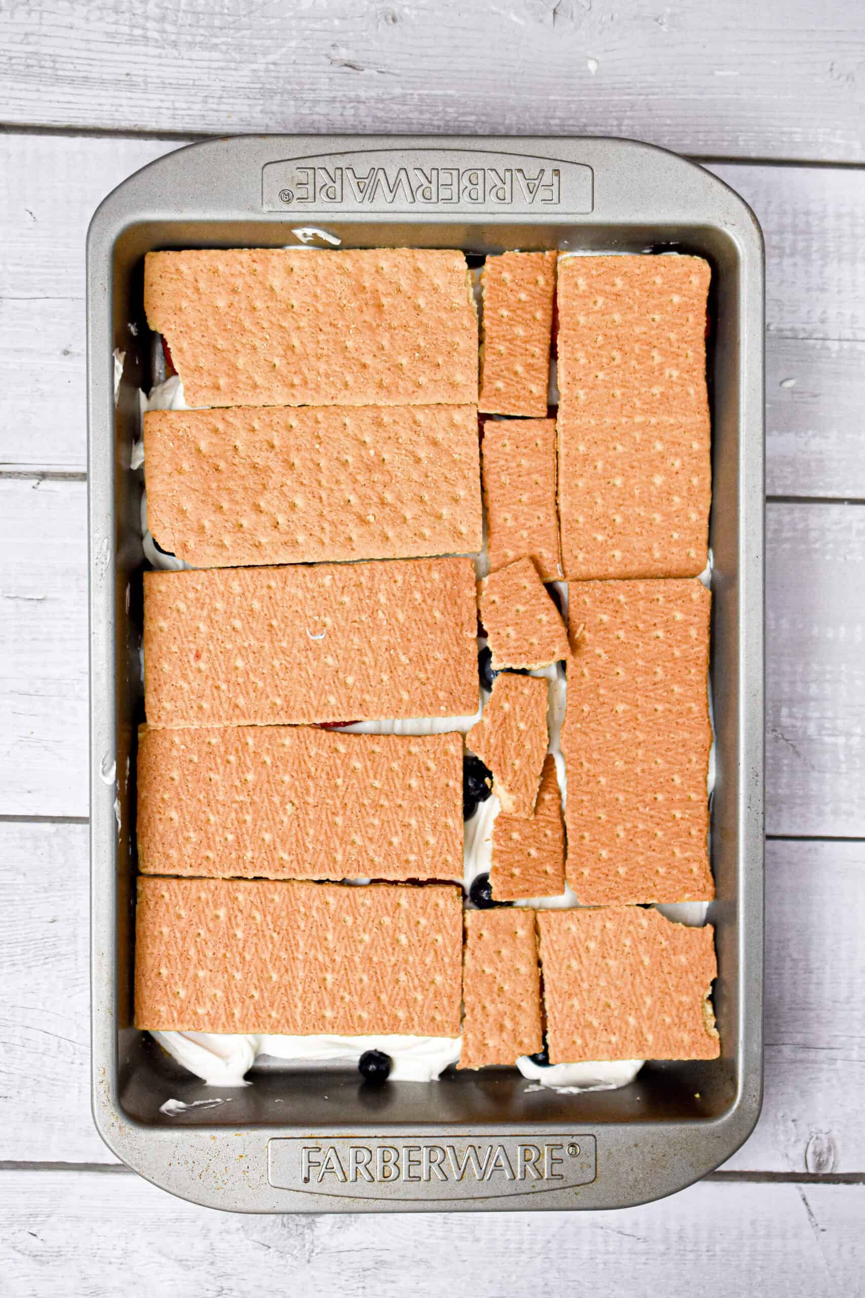 Another layer of graham crackers are added to the top of the berries