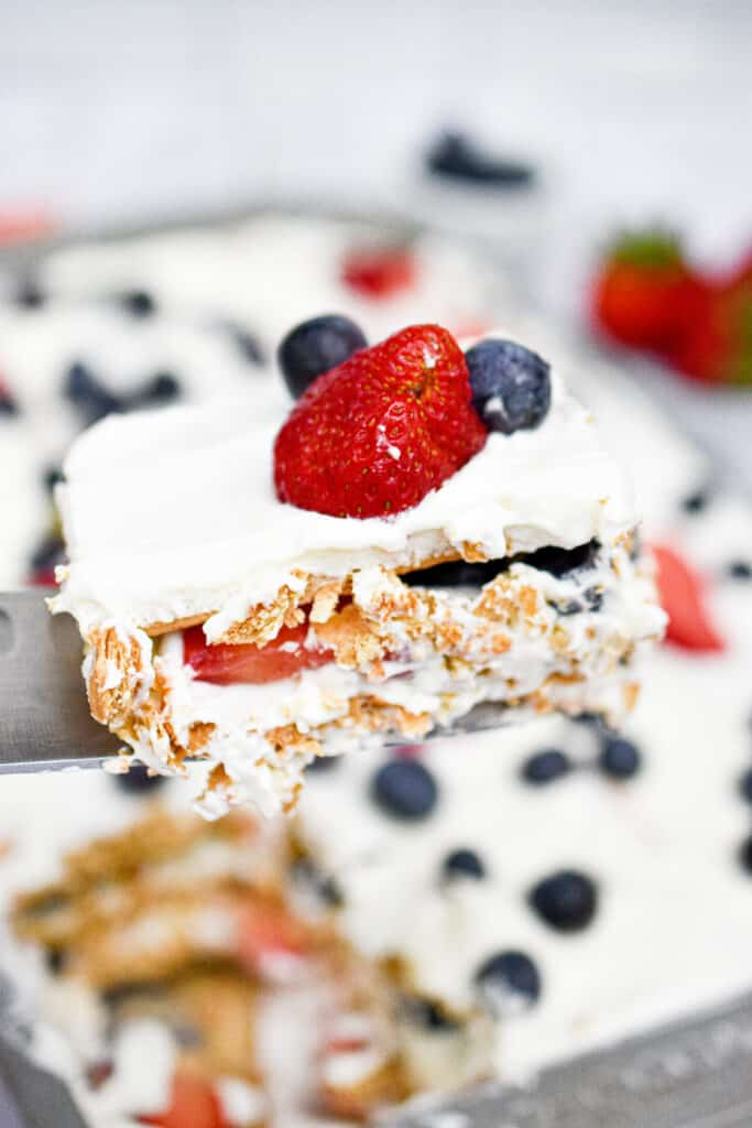 A close up of the slice of red white and blue icebox cake