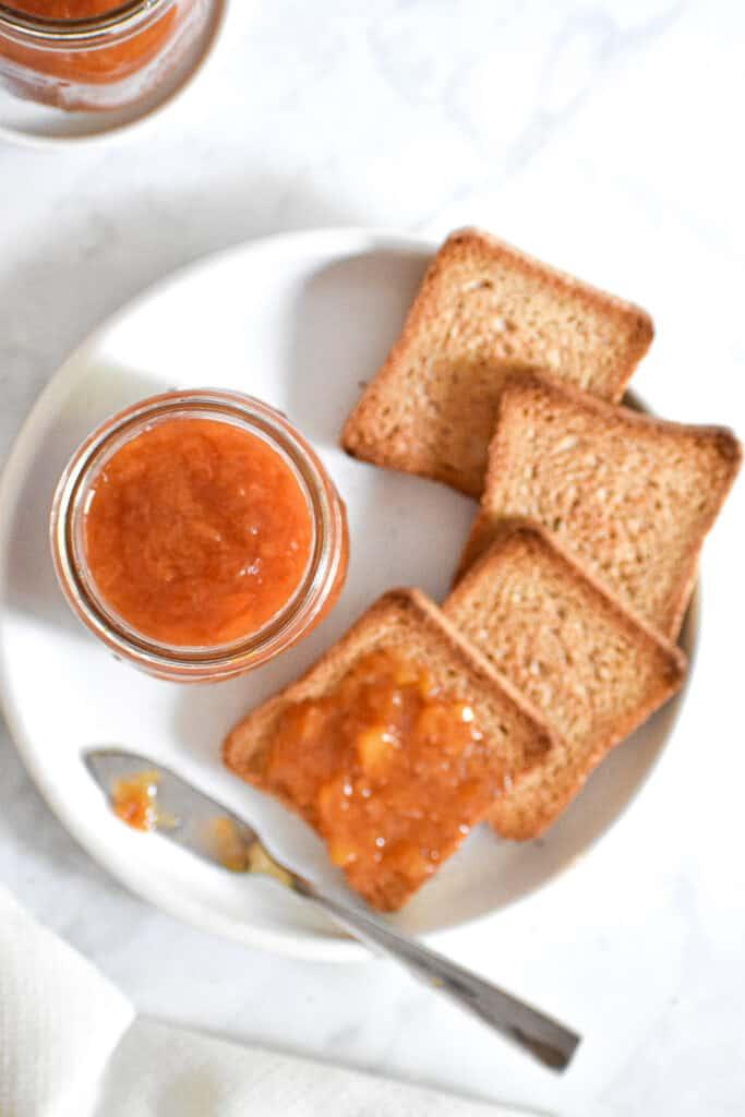 An overhead shot of the Instant Pot Peach Jam in a jar