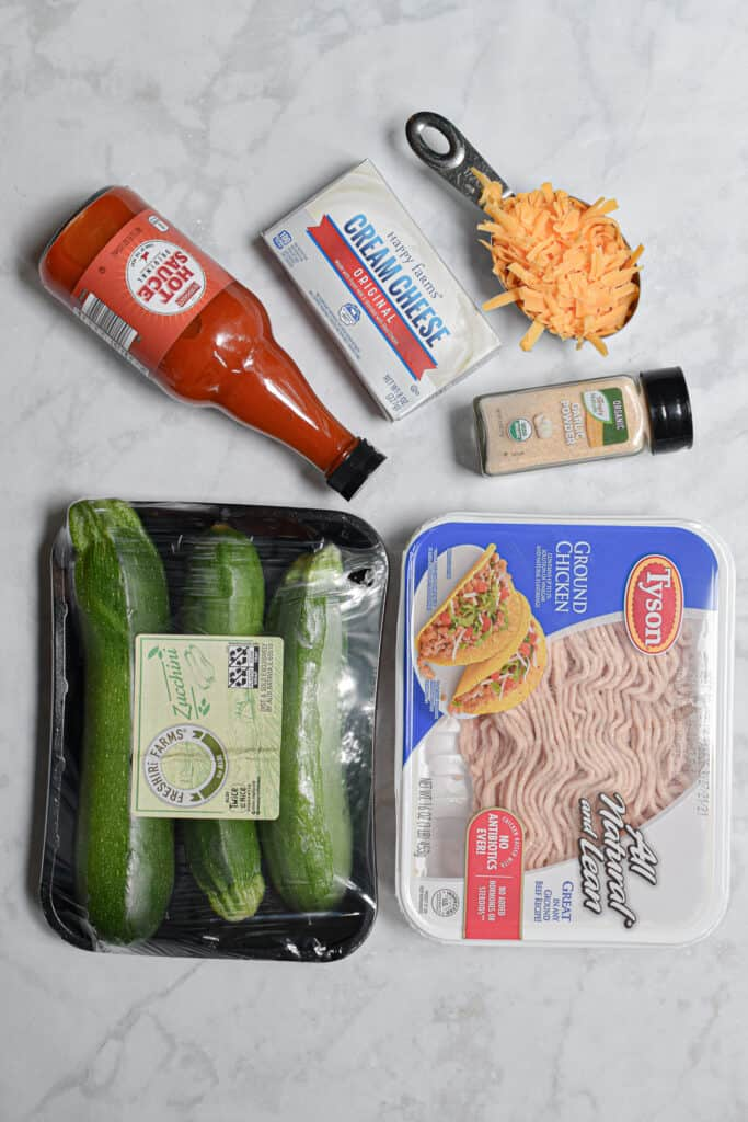 Ingredients for the Buffalo Chicken Stuffed Zucchini laid out