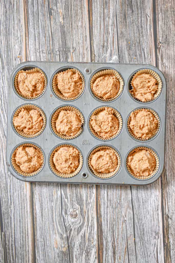 The muffin batter is added to muffin tins