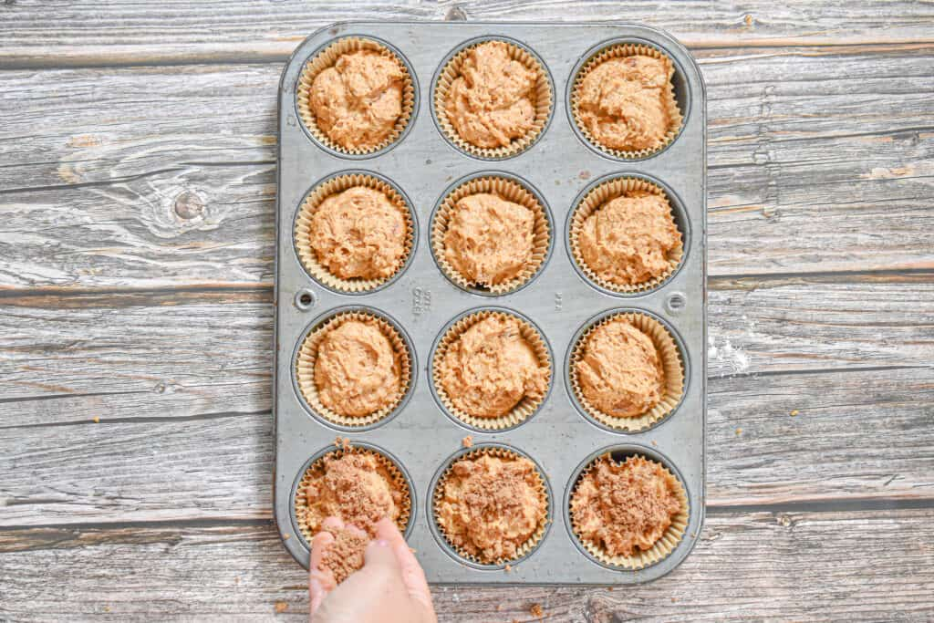The cinnamon sugar is added to the top of the pumpkin sourdough muffins