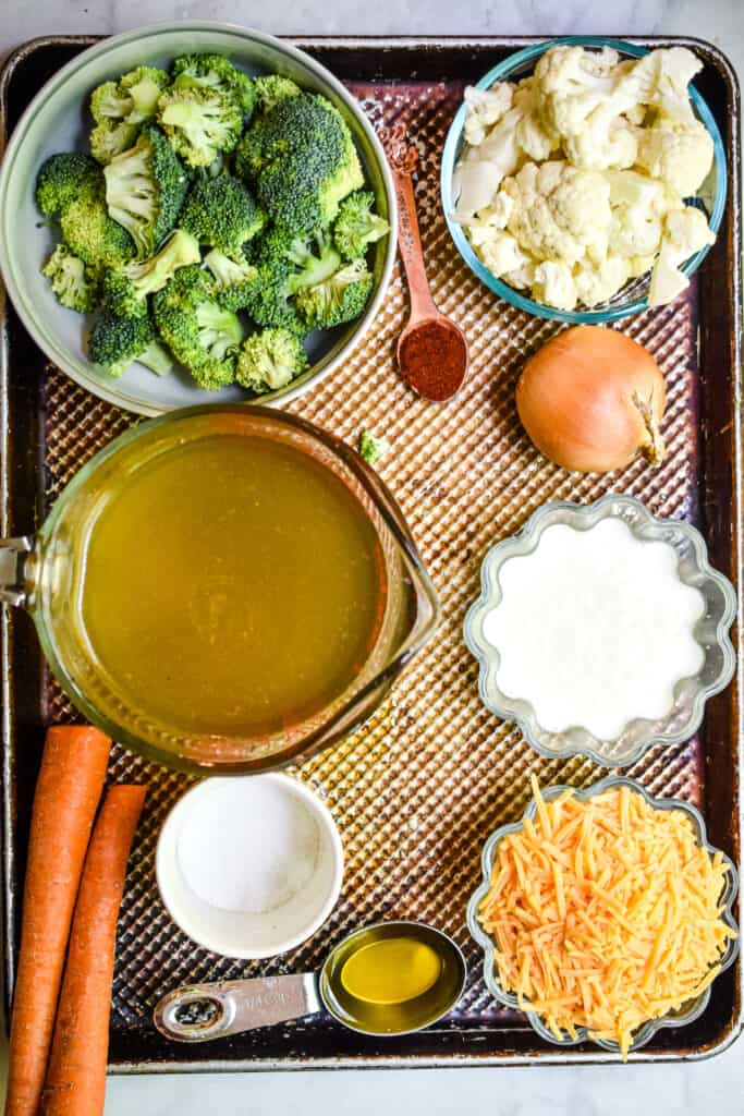 An overhead view of the ingredients for the roasted broccoli and cauliflower soup