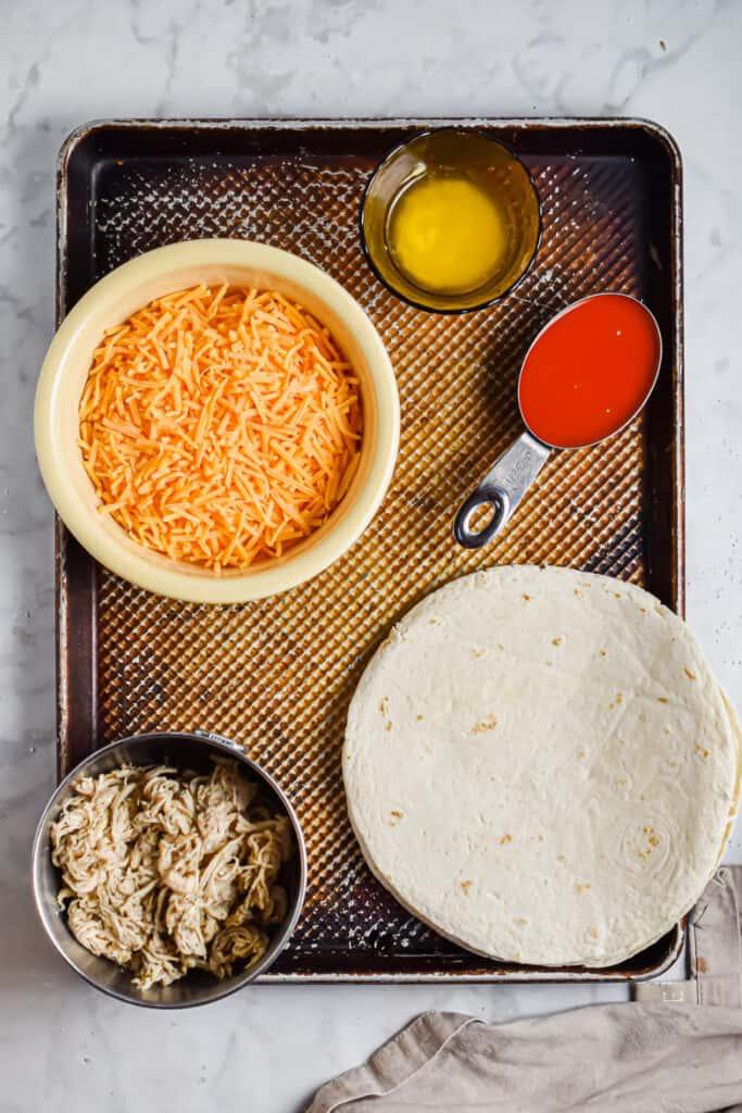 Ingredients for the buffalo chicken sheet pan quesadillas