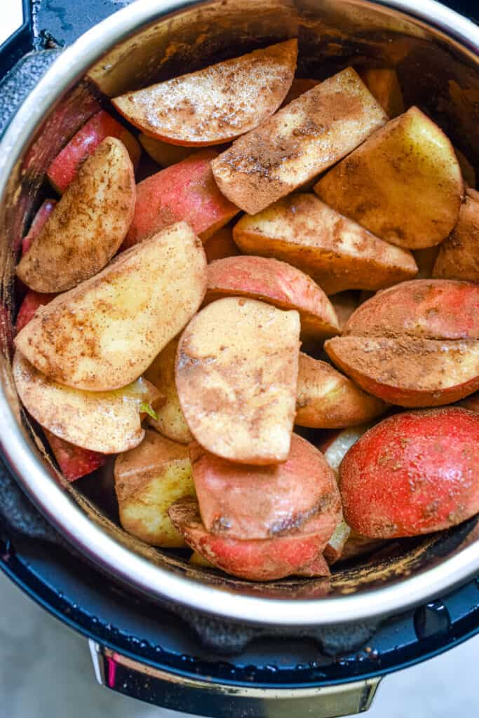 The apples and other ingredients are mixed together in the Instant Pot