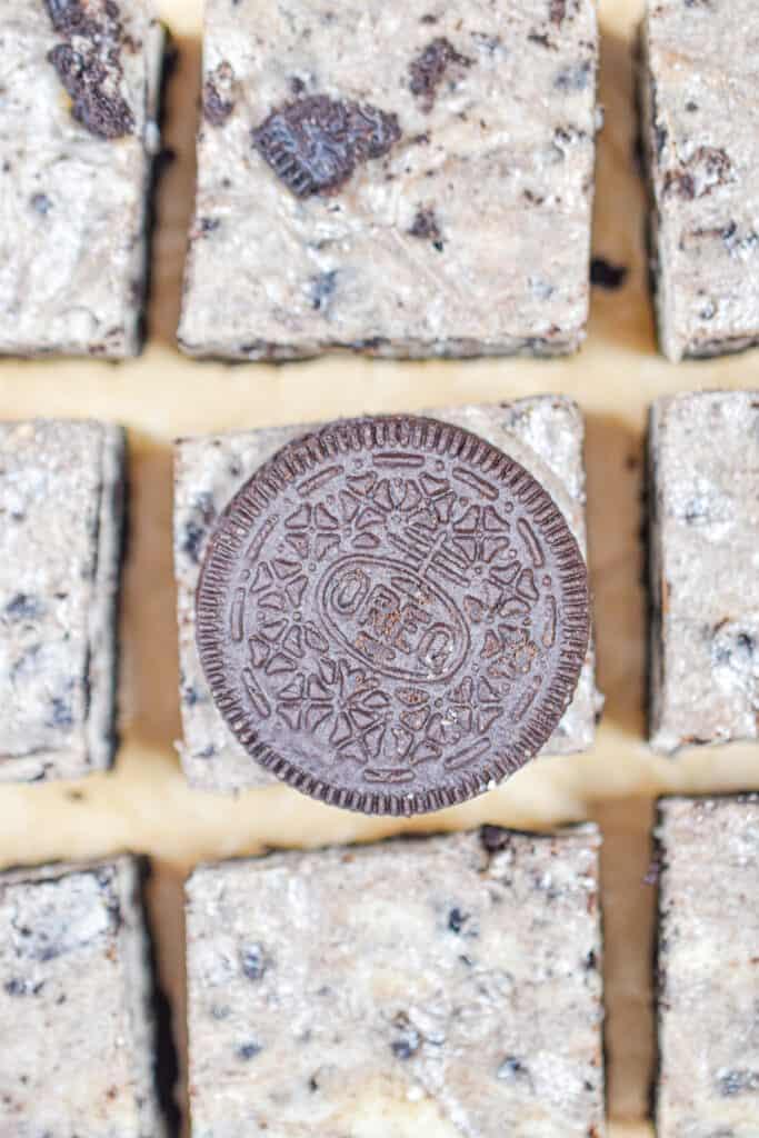 An Oreo tops the Oreo cheesecake bars in an overhead shot