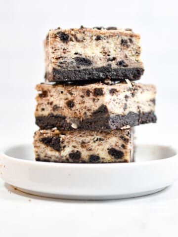 Three Oreo Cheesecake Bars are stacked