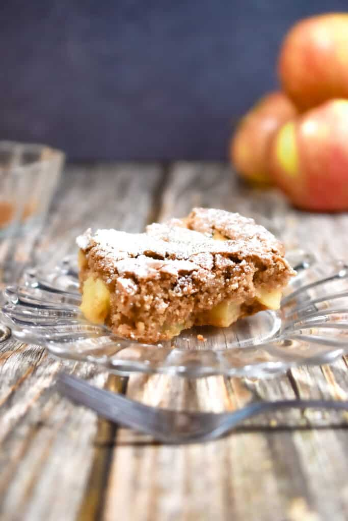 A slice of the all in one apple cake on a plate