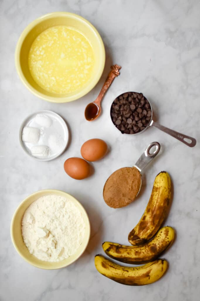 An overhead shot of the ingredients for the one bowl chocolate chip banana bread
