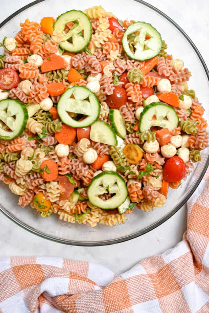 The Halloween pasta salad is on the top of the frame with a dish cloth below it