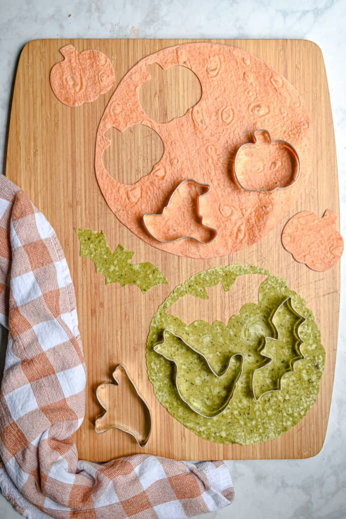 The tortillas and Halloween cookie cutters are laid out