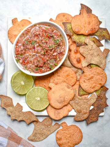 An overhead shot of the chips surrounding a bowl of salsa